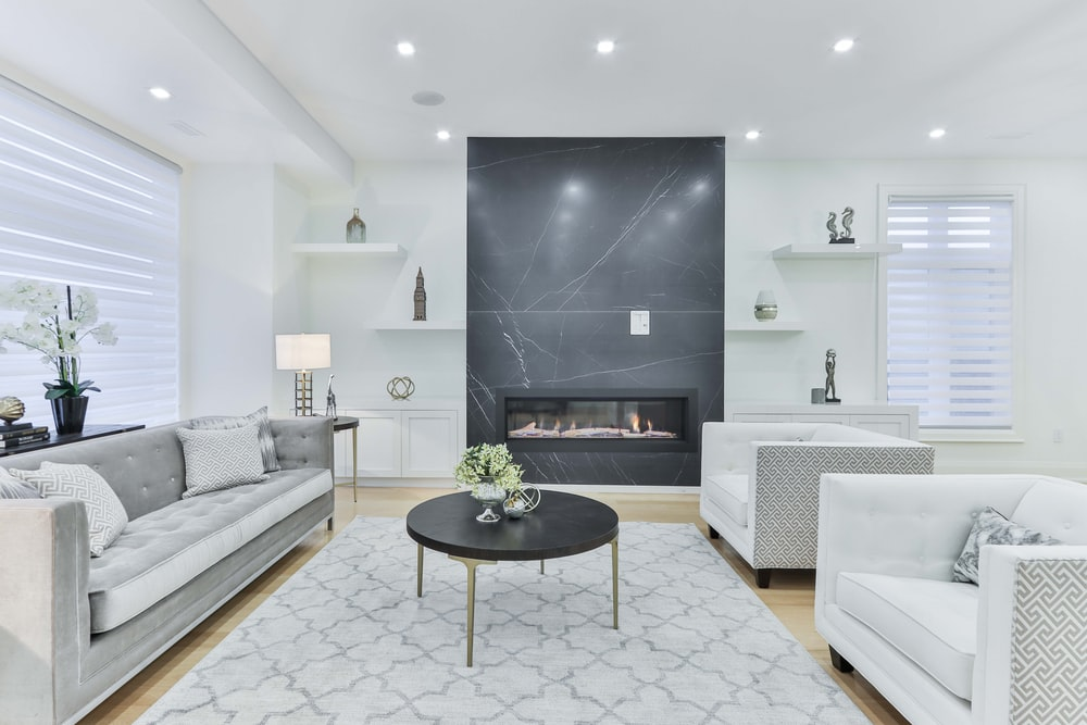 white couch beside black round table