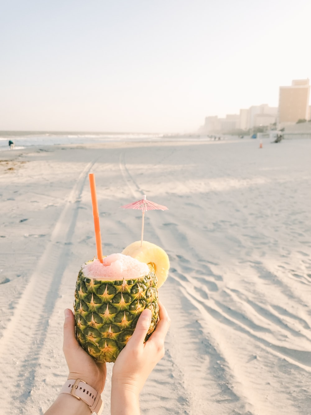 pineapple juice on brown sand