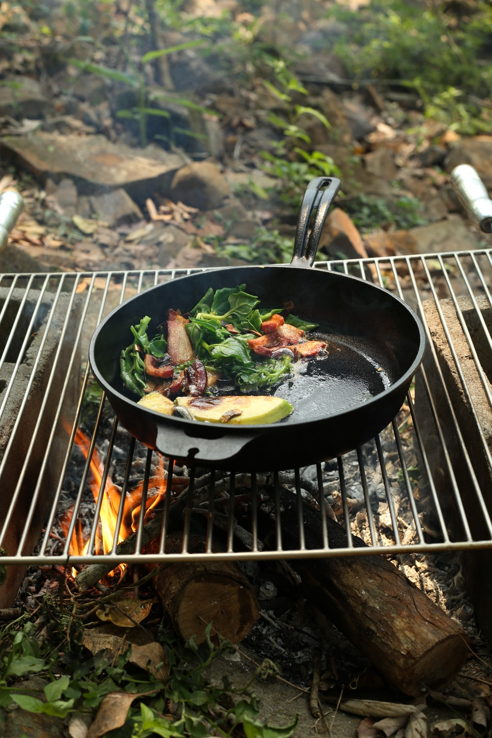 black cast iron pan on charcoal grill