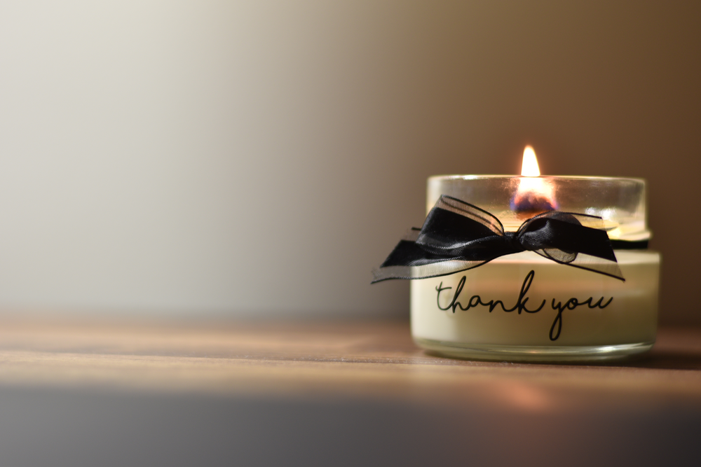 white and black candle holder