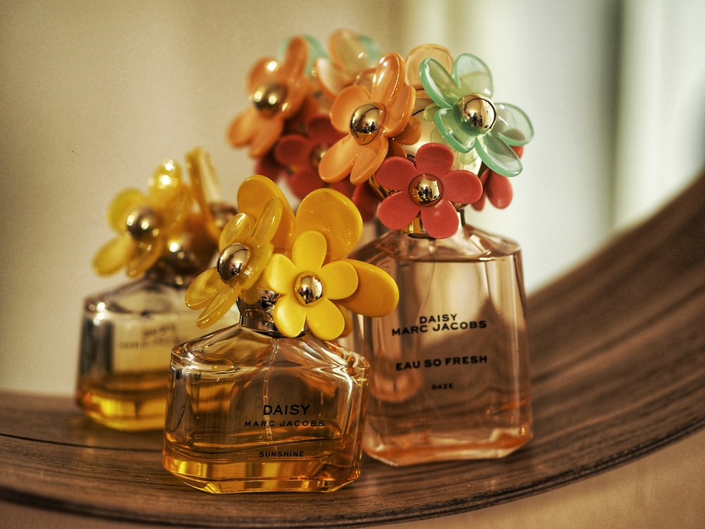 selective focus photography of 50 ml perfume bottle