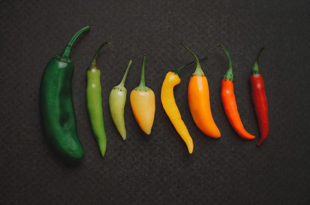 orange and green chili peppers