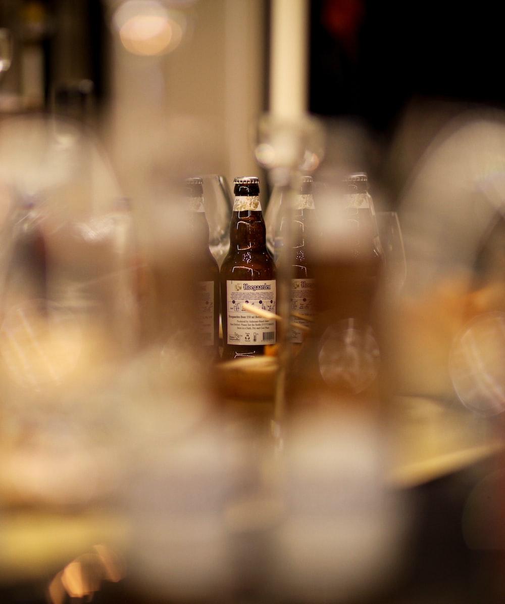 tilt shift lens photography of clear glass bottles