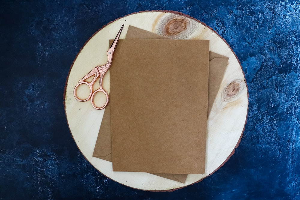 brown paper on white and blue round plate