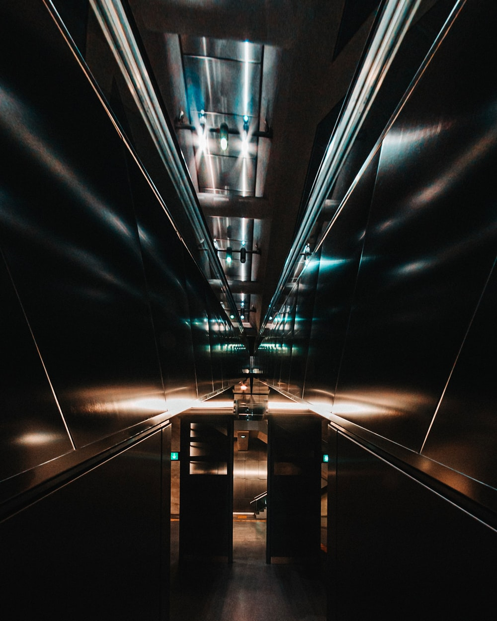 black and white tunnel with lights