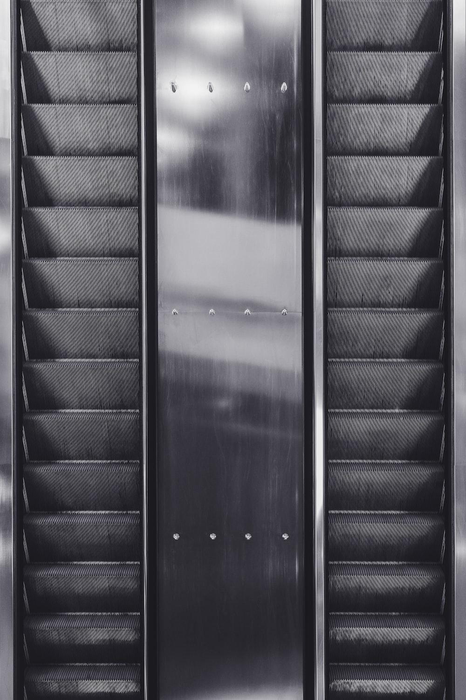 black wooden door with stainless steel door lever