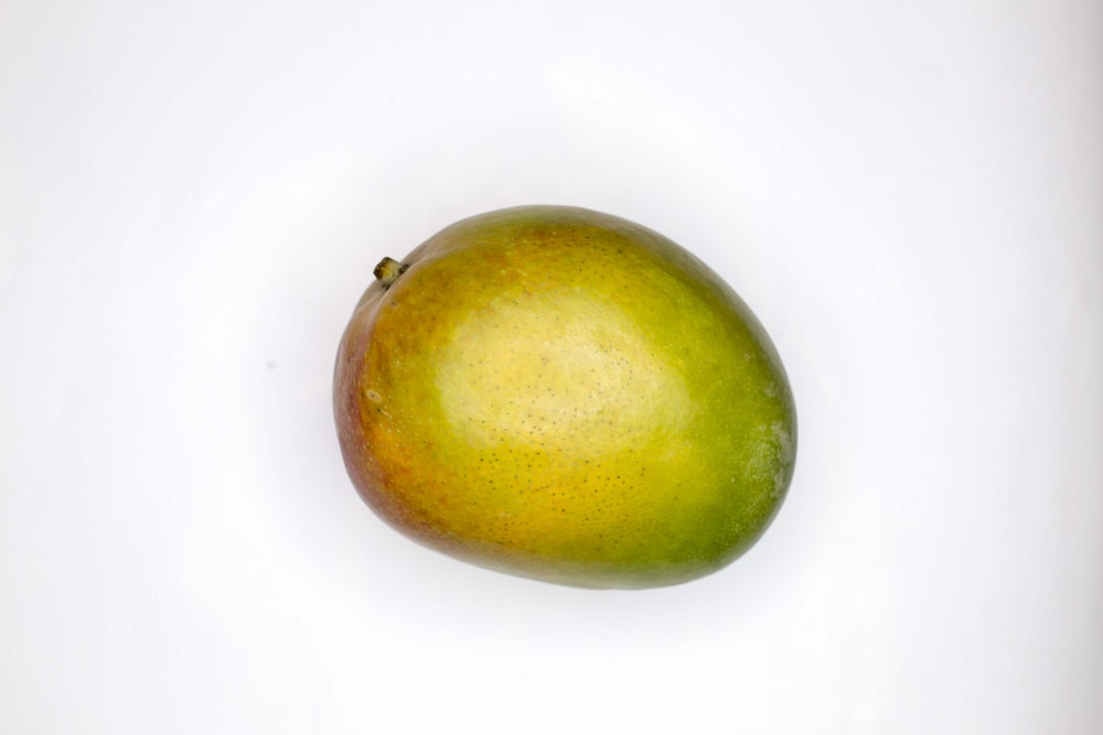 green round fruit on white surface