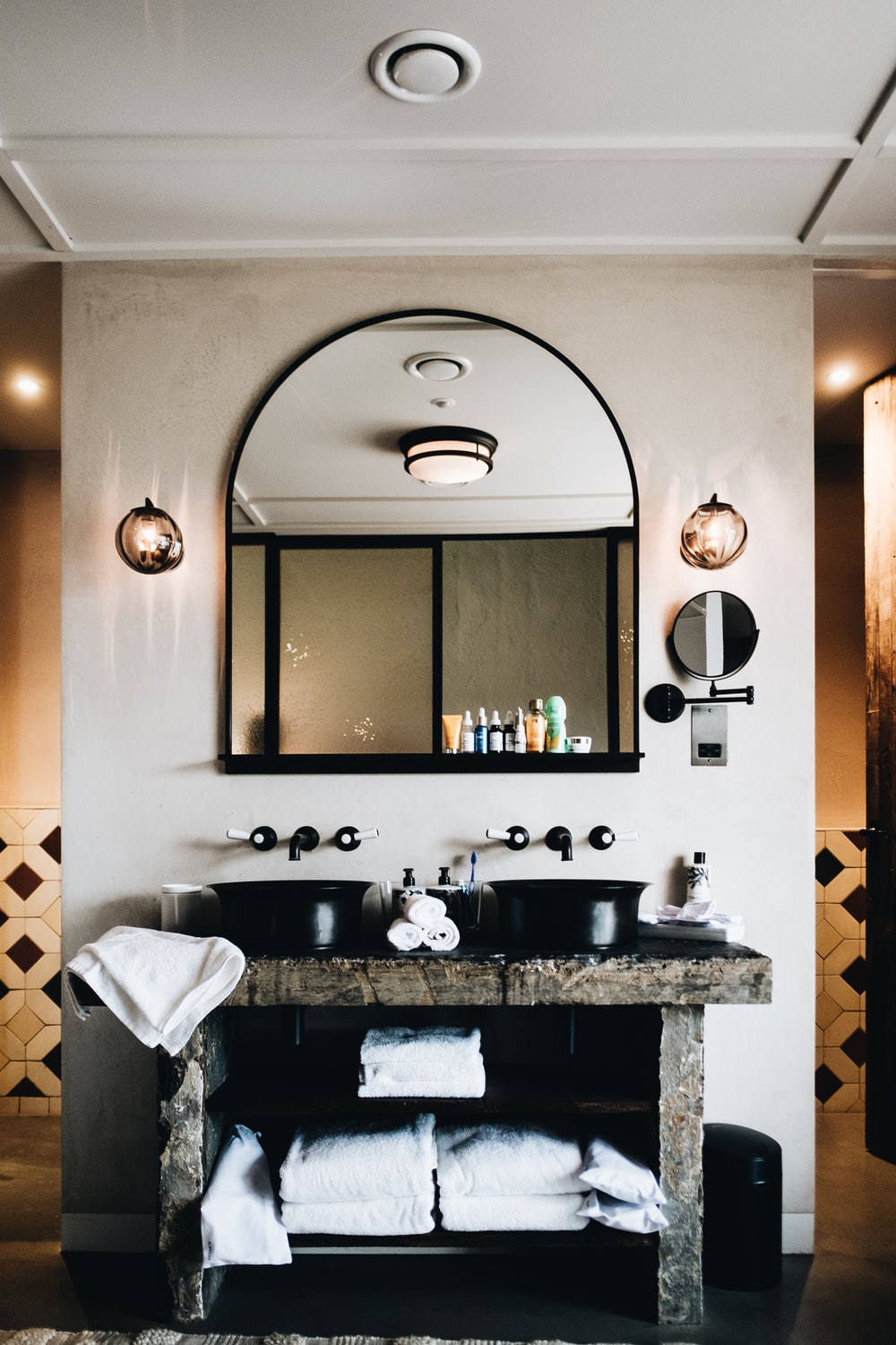 white towel on black and white marble sink