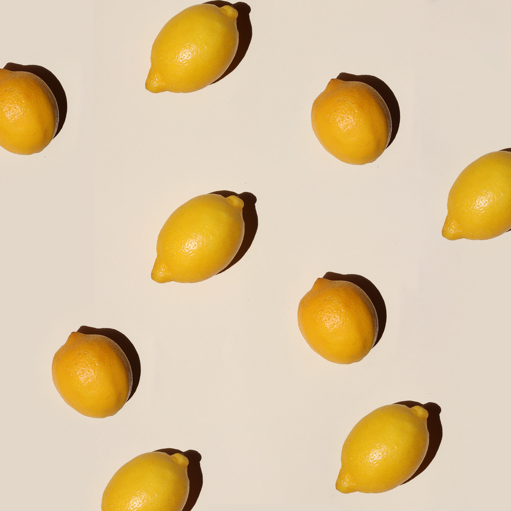 yellow lemon fruits on white surface
