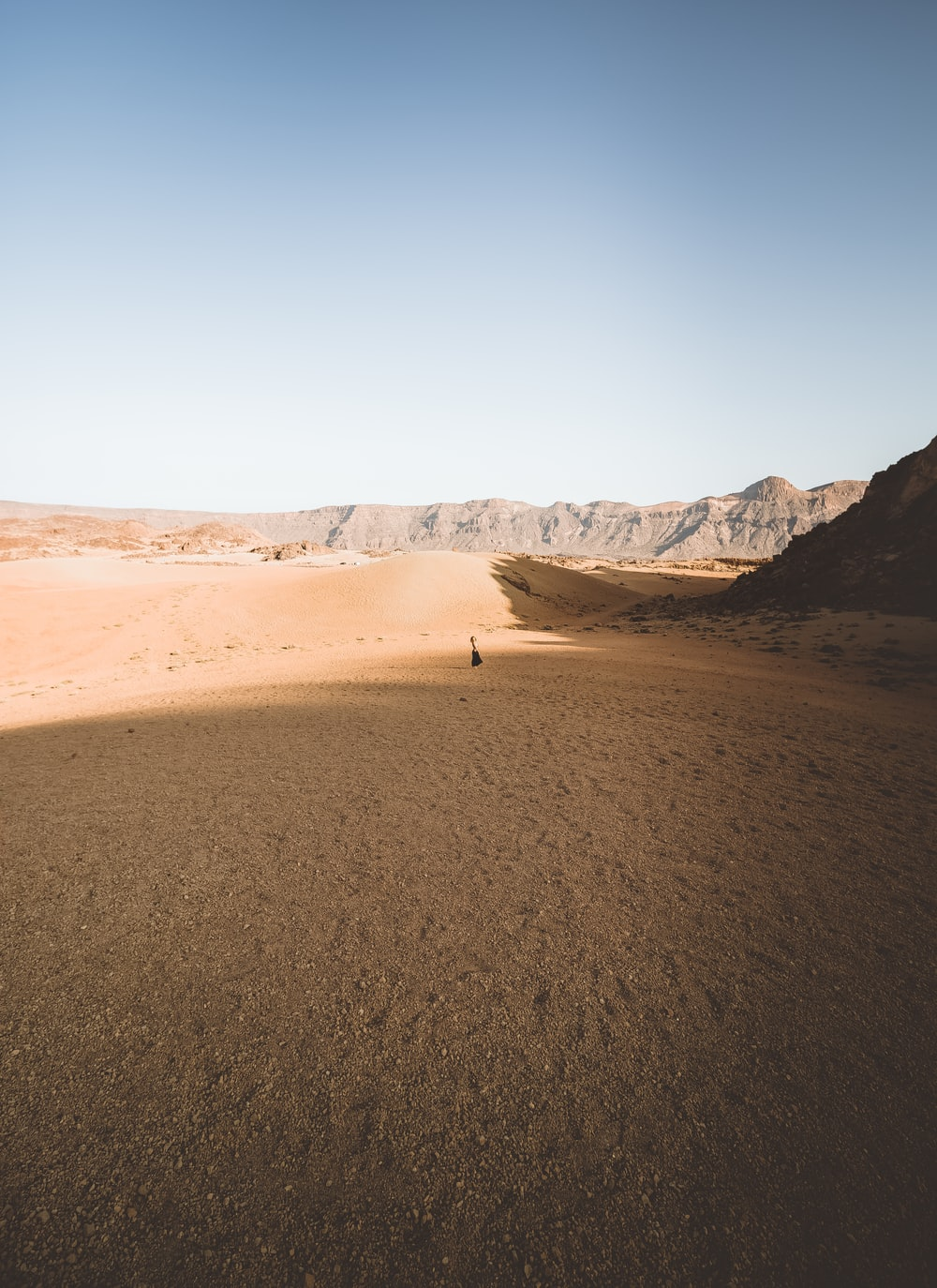 brown sand and brown mountain