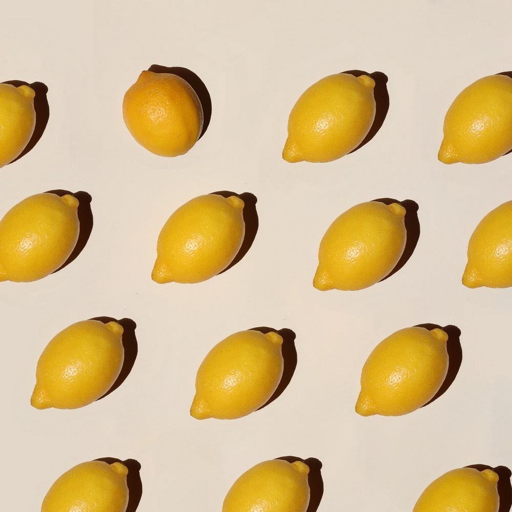 yellow fruit lot on white surface