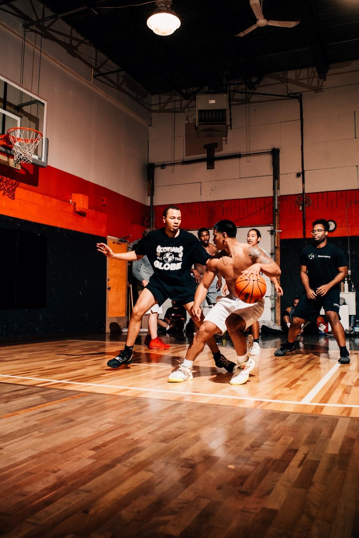 basketball players playing on court