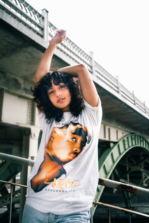 woman in white t-shirt raising her hands
