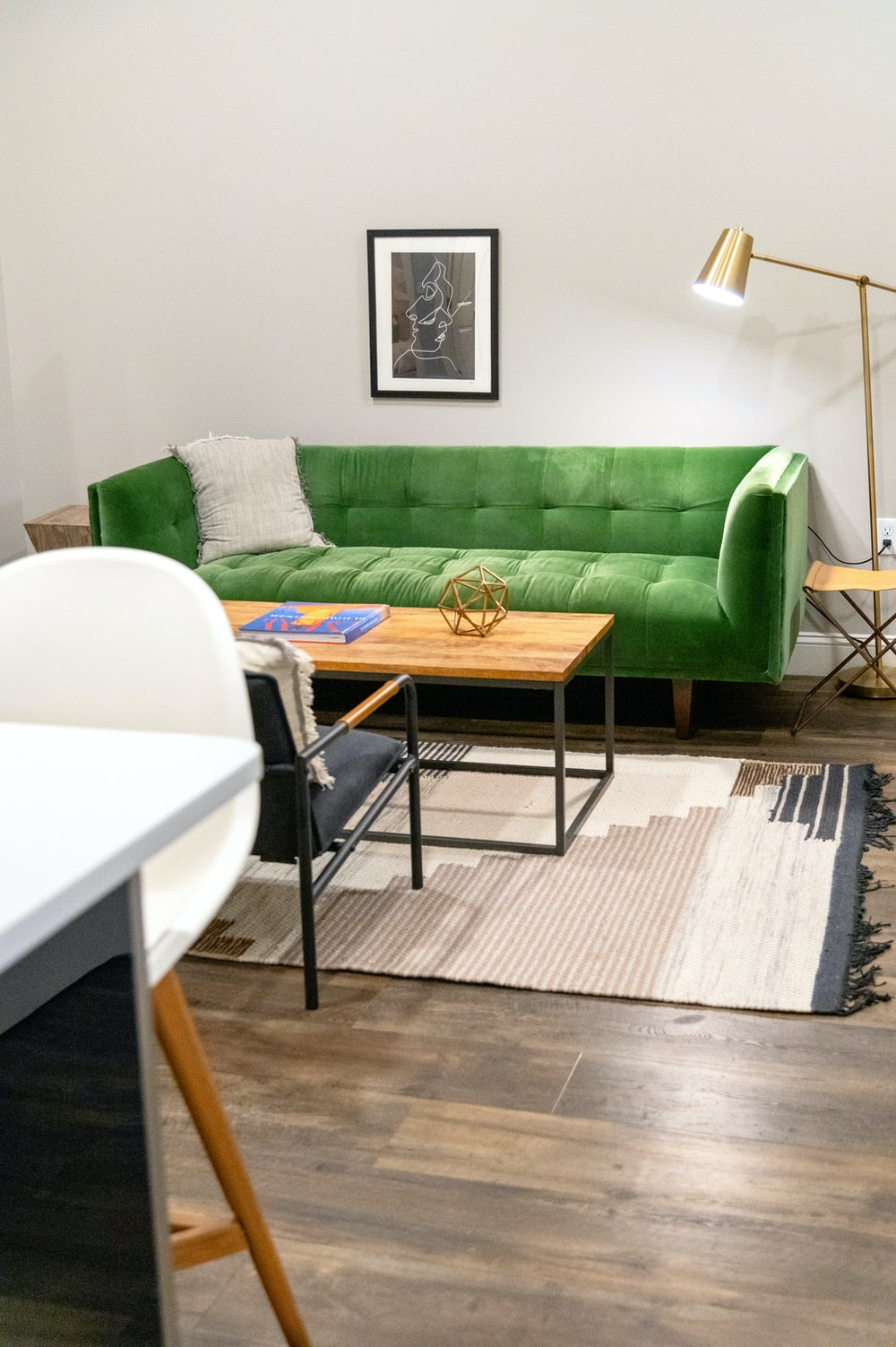 green sofa beside white table