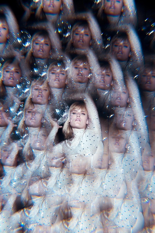 woman in white dress lying on water