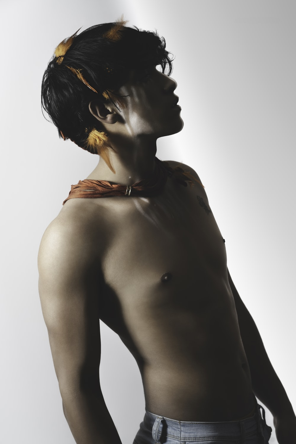 topless man with black hair