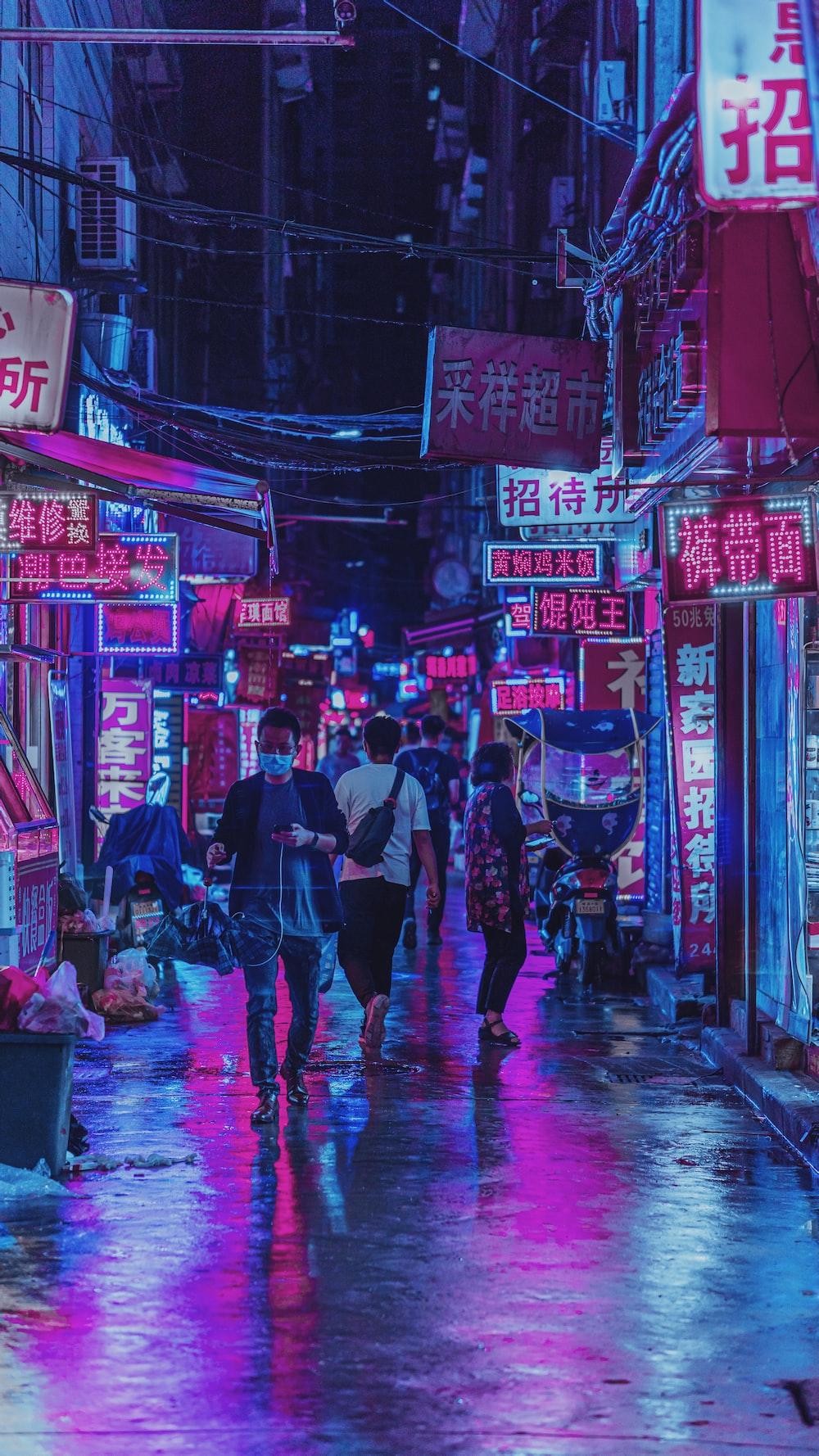 people walking on street during nighttime