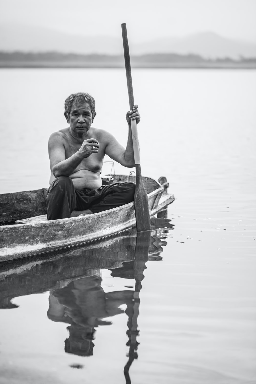 man in boat on water