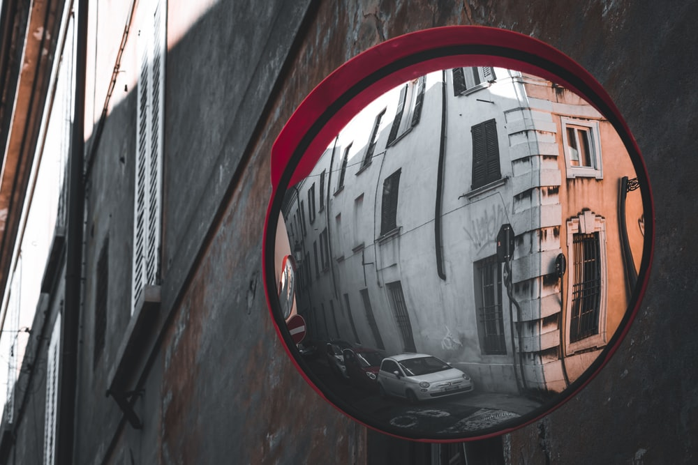 red round mirror on brown wooden wall