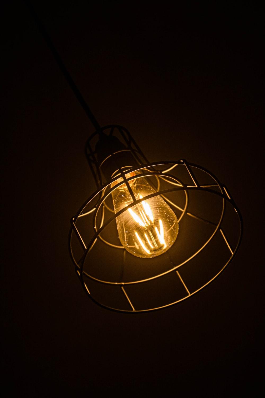 white round pendant lamp turned on in dark room