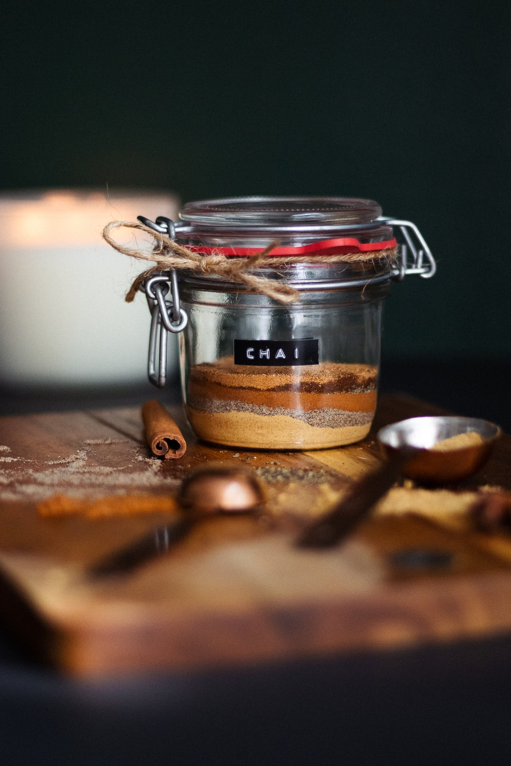 clear glass jar with brown powder on brown wooden table