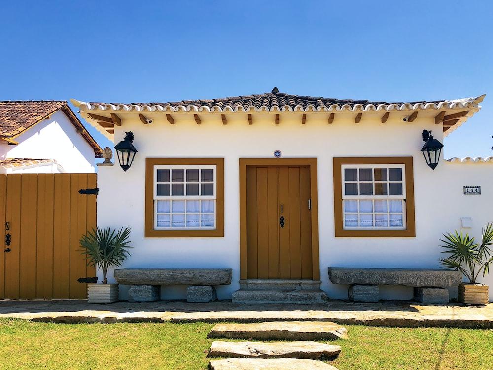 brown wooden door on brown concrete house