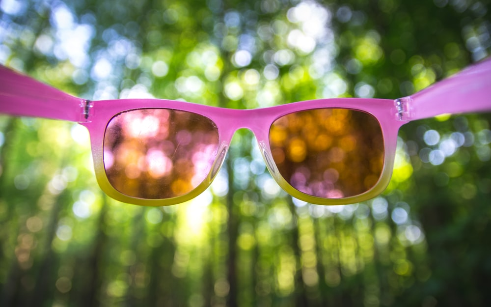pink framed sunglasses with yellow lens