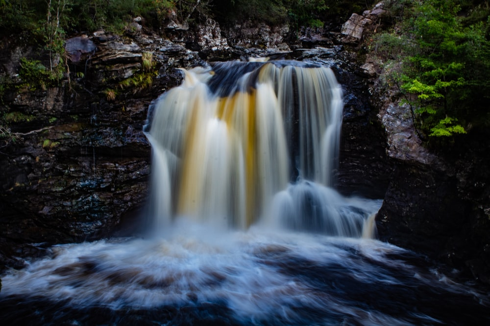 time lapse photography of water falls