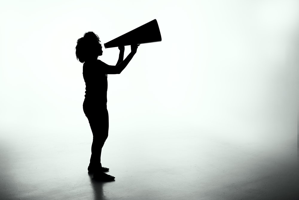 silhouette of woman holding rectangular board