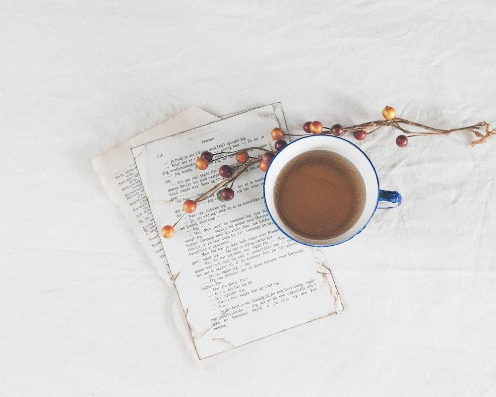 white ceramic mug on white printer paper