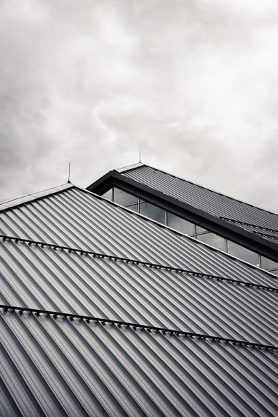 gray and black building under white clouds