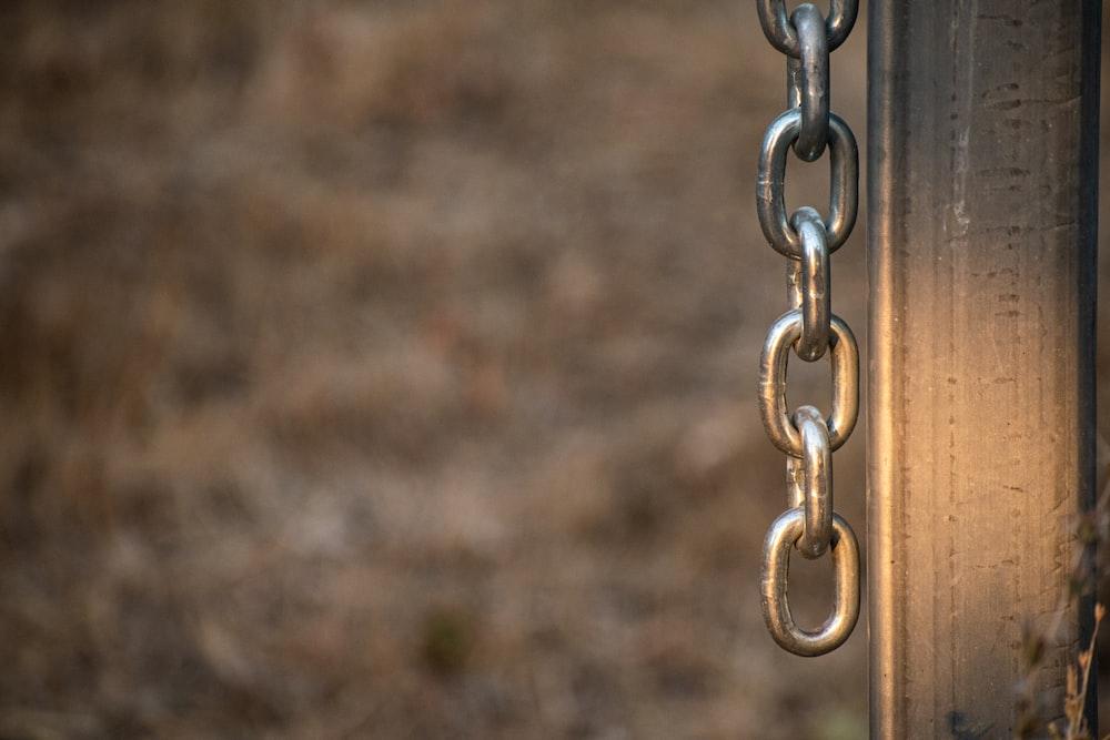 silver chain on brown soil