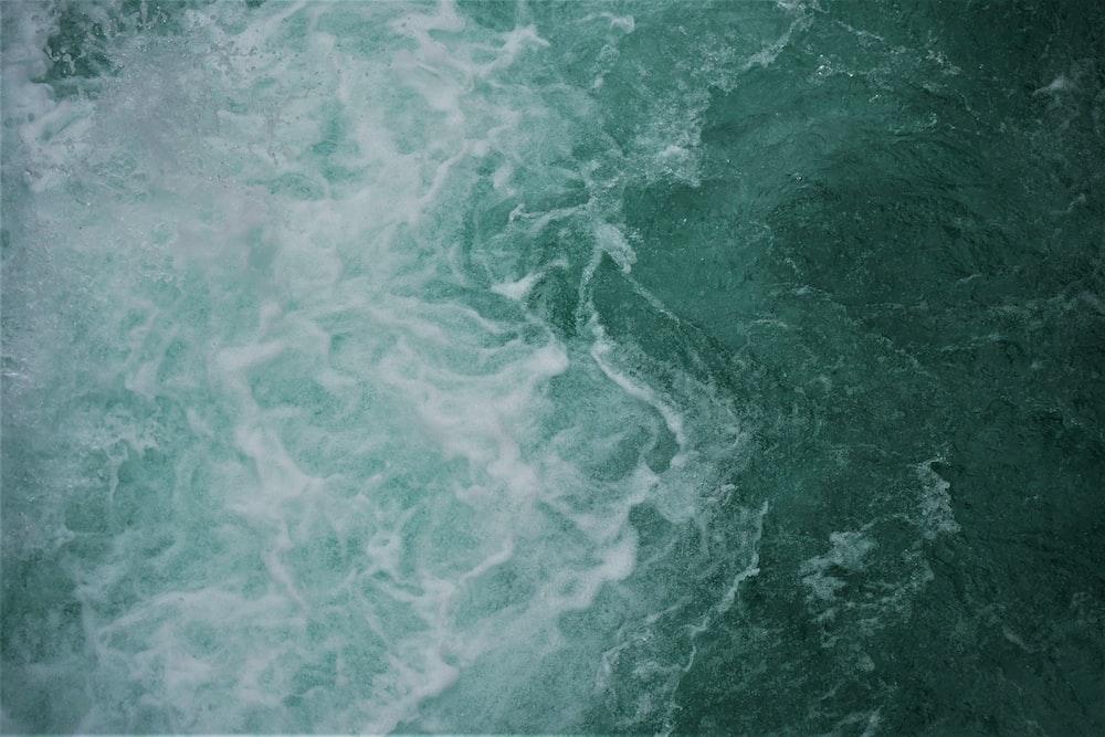 green water waves during daytime