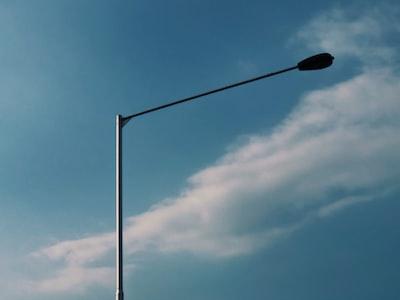 black street light under blue sky during daytime post-impressionism zoom background