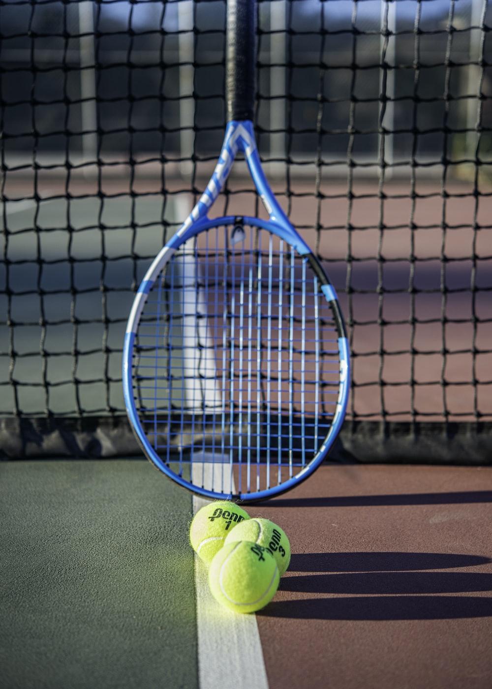 green tennis ball on tennis court