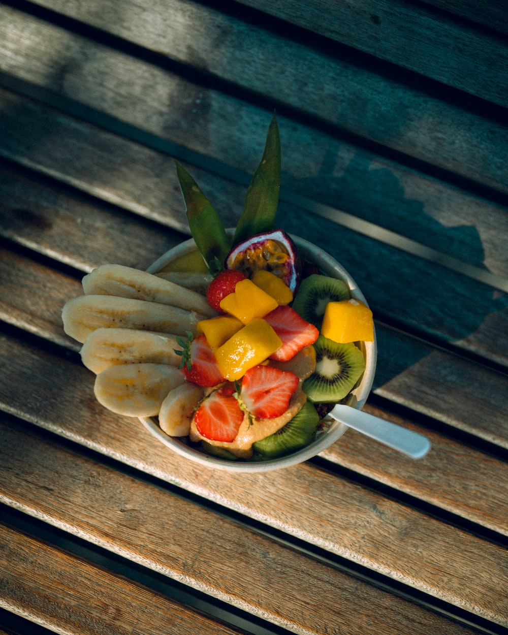 sliced fruits on brown wooden chopping board
