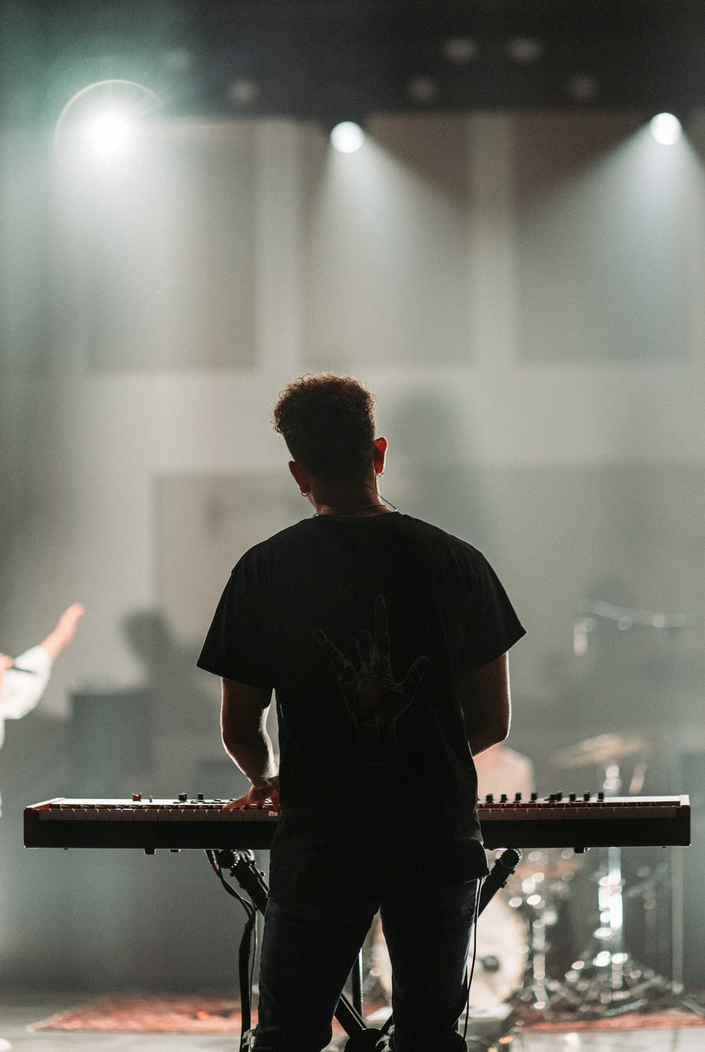 man in black crew neck t-shirt playing piano
