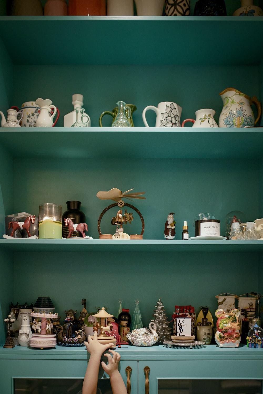 white ceramic tea set on green wooden shelf