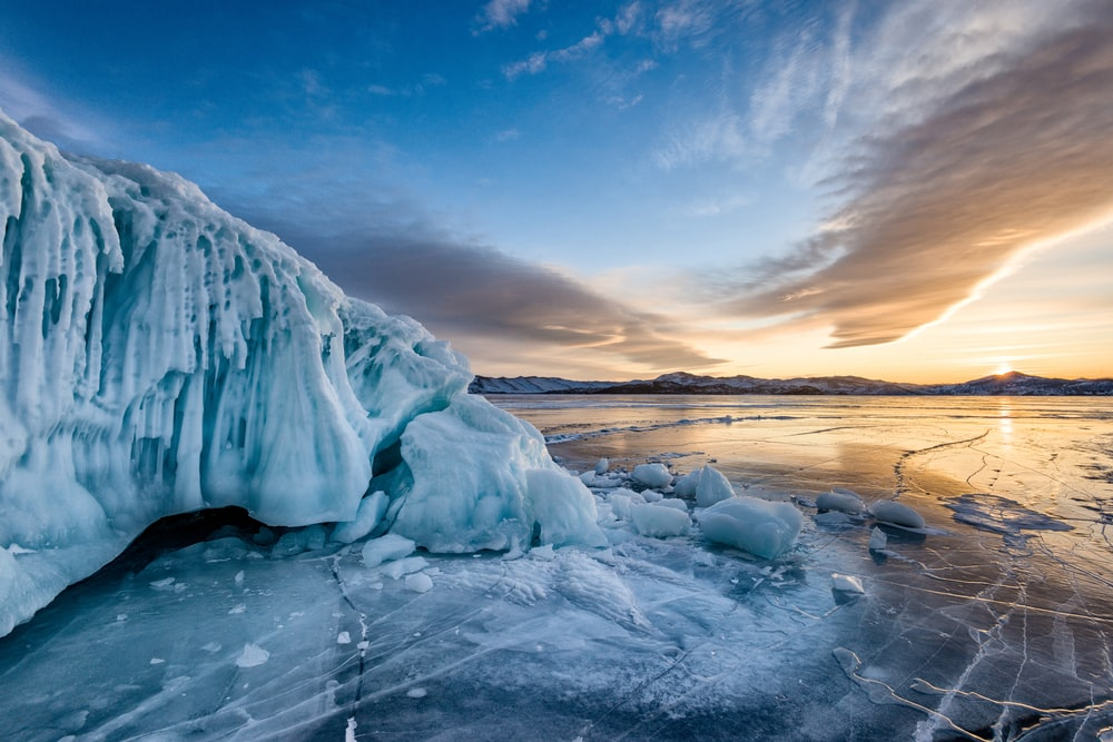 ice formation on body of water under blue sky during daytime