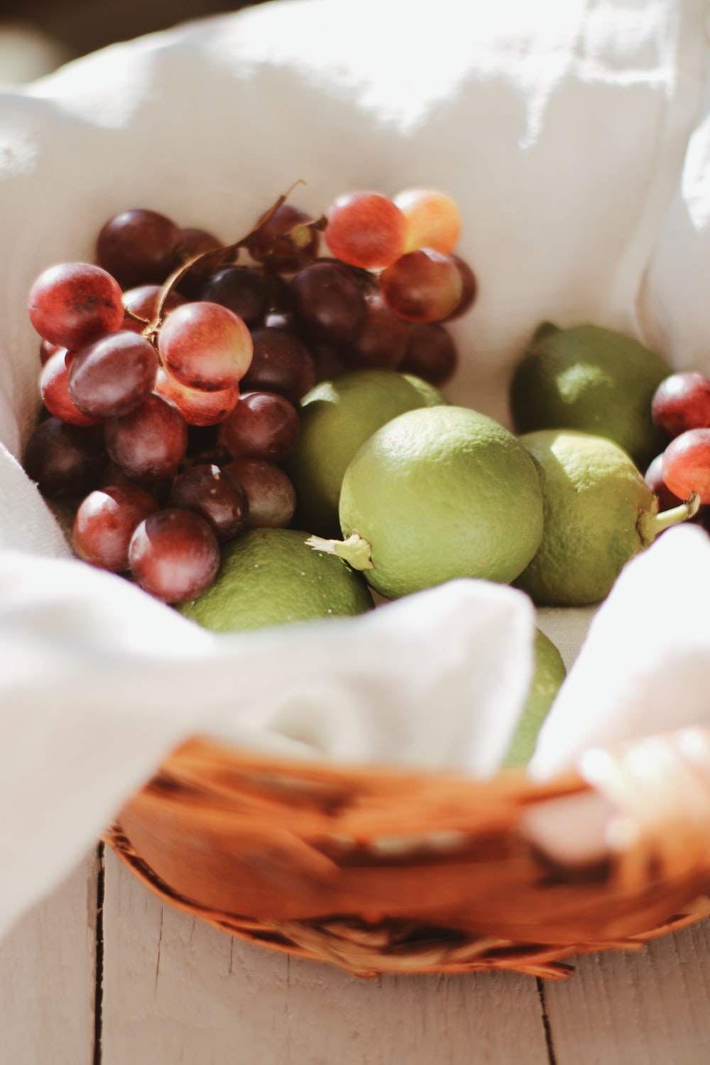 green and brown round fruits on white plastic bag
