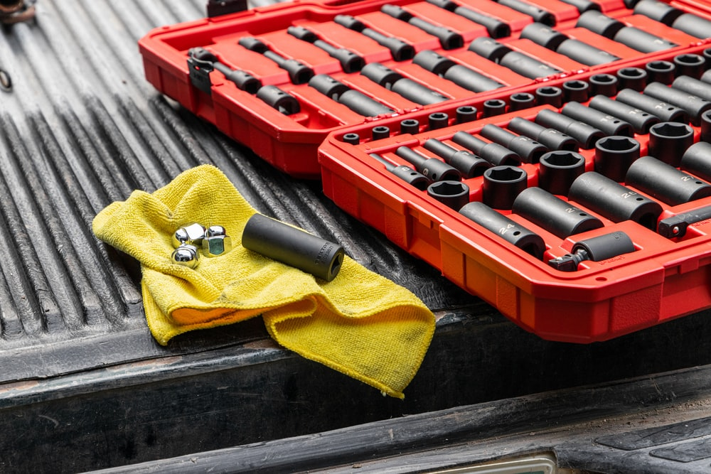 yellow textile on red and black plastic crate