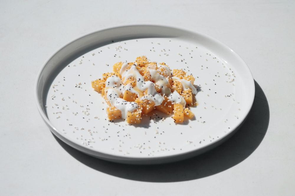white ceramic round plate with rice