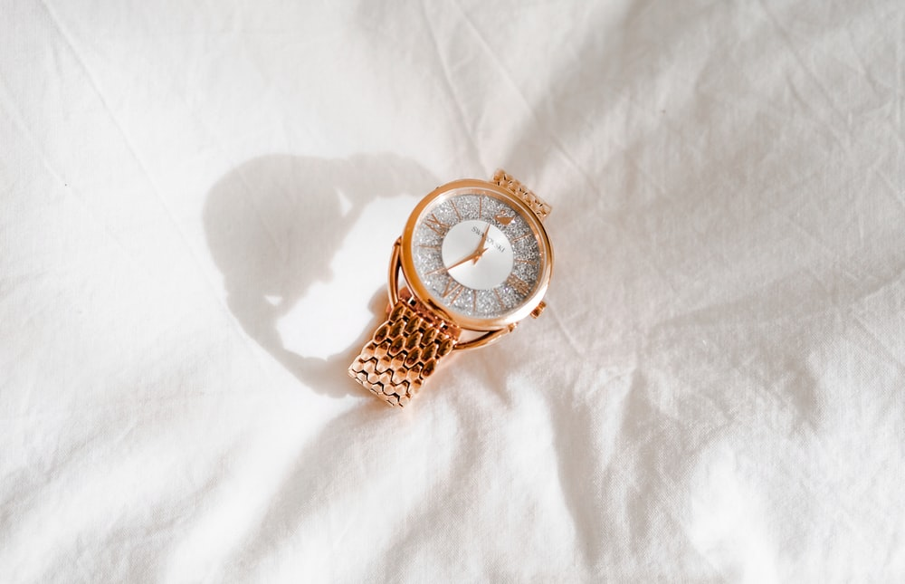gold and silver analog watch
