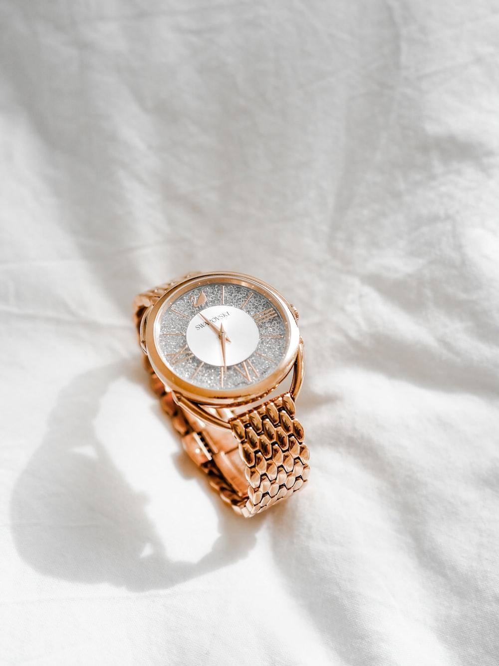 gold link bracelet round analog watch