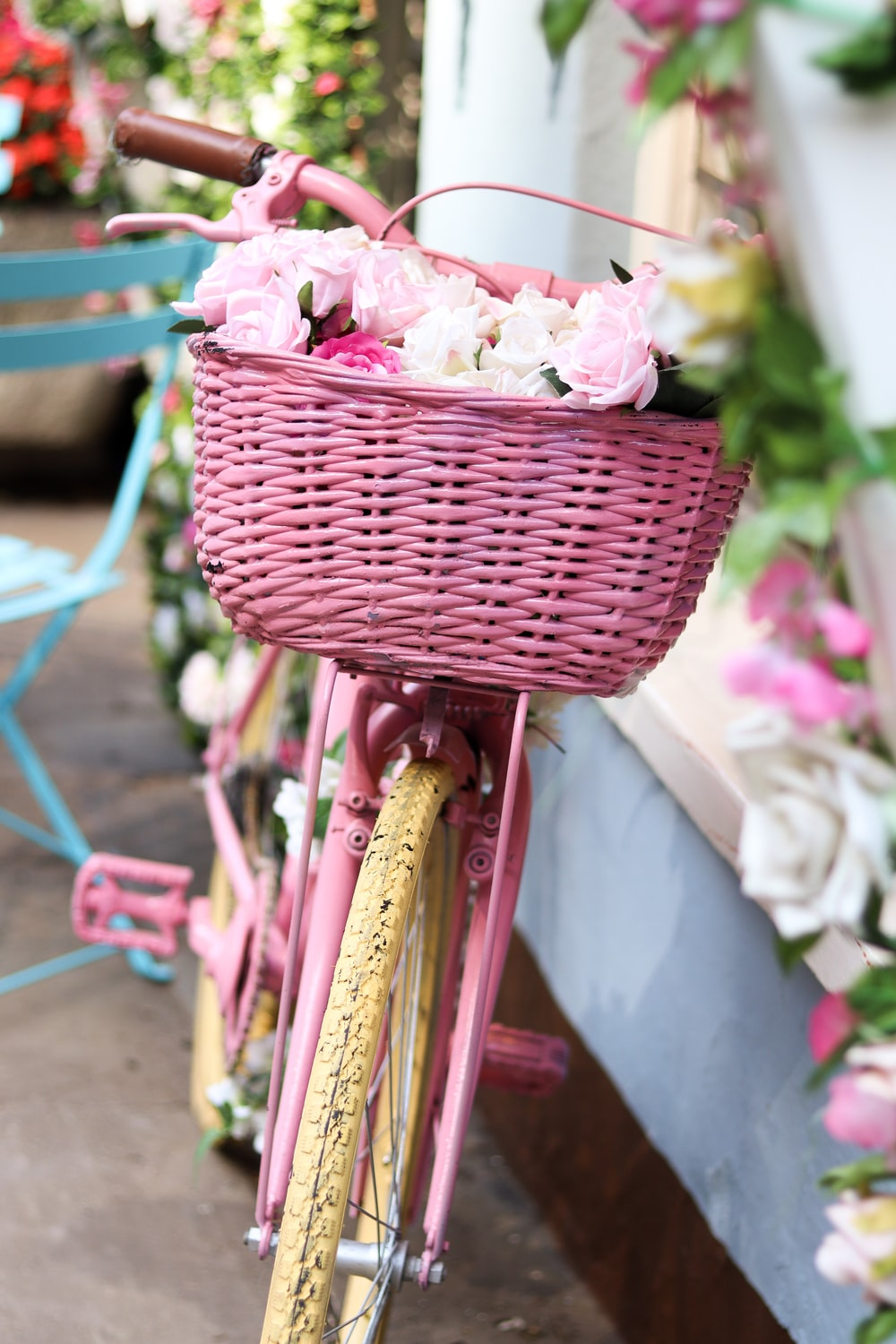 pink and white flowers in pink woven basket