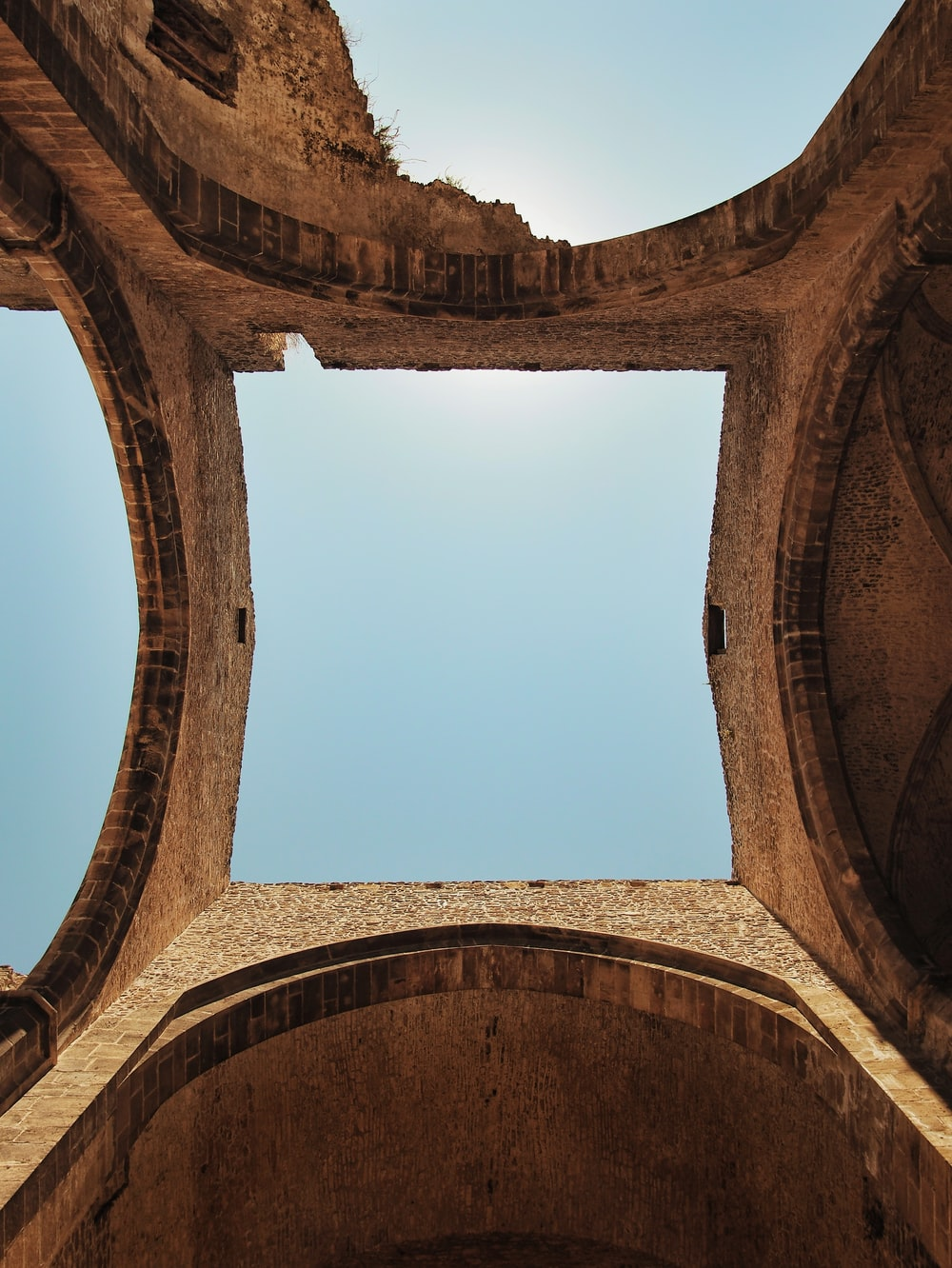 brown concrete arch under blue sky during daytime