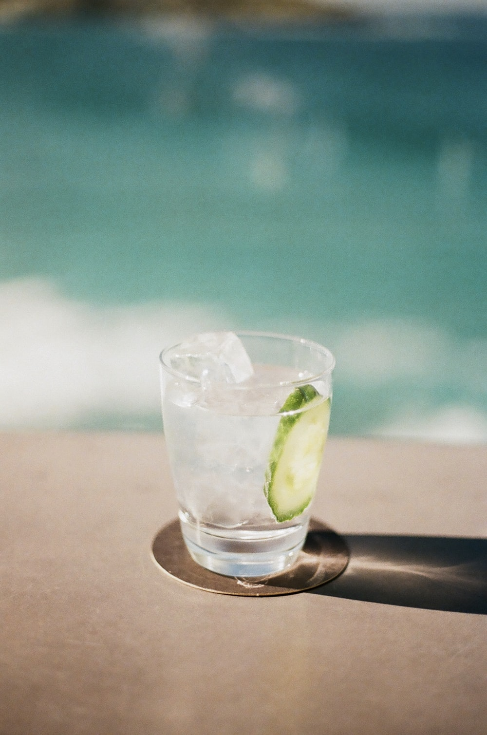clear drinking glass with sliced lime