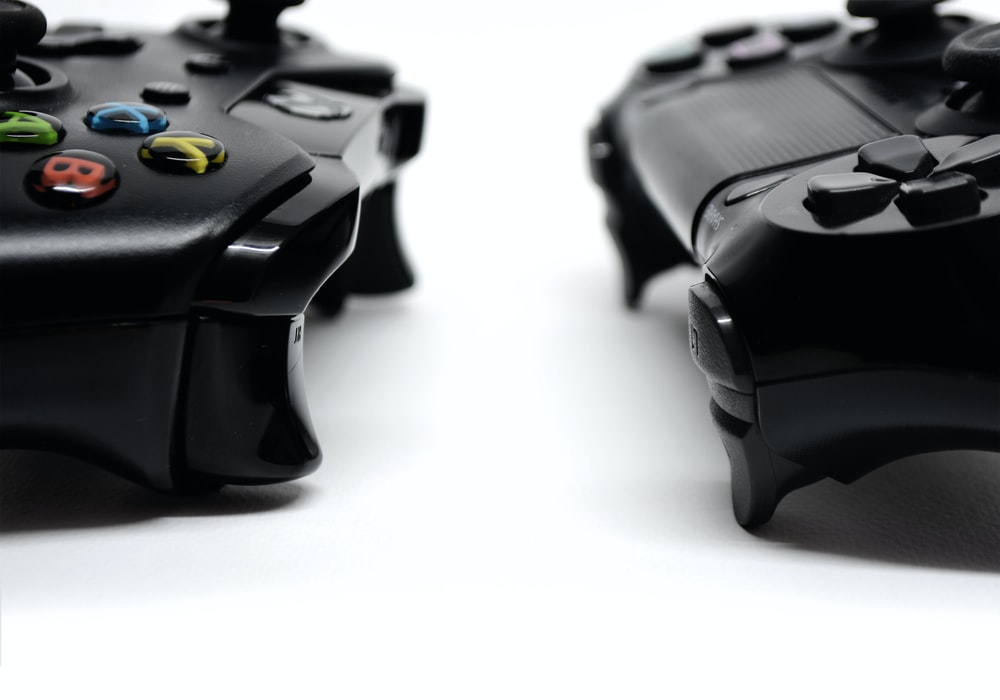 black game controller on white surface