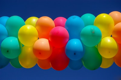 blue pink yellow and green balloons decorations zoom background