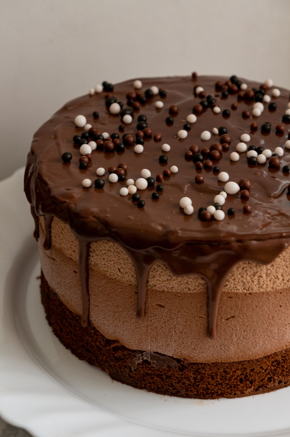 chocolate cake with white icing on top
